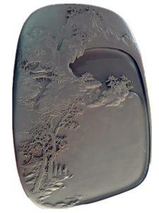 piedra para tinta tallado con escena de montaña y templos
