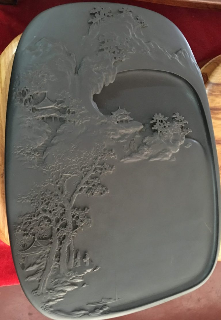 inkstone carved with mountain scene and temples