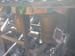 Tibetan prayer wheels turning forever in the water