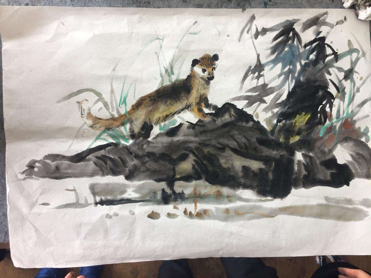 a weasel in garden